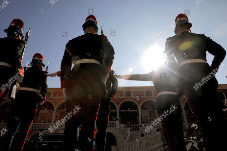Members of the Monaco Royalty Guards stand guards as Chinese President Xi Jinping leaves the Royal Palace after a meeting with Prince Albert II of Monaco in Monaco, 24 March 2019. Chinese President is in Monaco for a one day state visit.