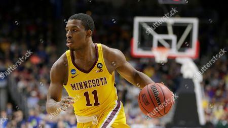 Minnesota's Isaiah Washington (11) during the first half of a second round men's college basketball game against Michigan State in the NCAA Tournament, in Des Moines, Iowa