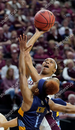 Texas A&M's Shambria Washington shoots as Marquette's Danielle King (1) defends during the first half of a second round women's college basketball game in the NCAA Tournament, in College Station, Texas
