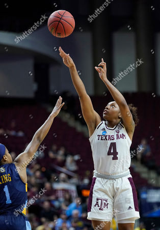 Texas A&M's Shambria Washington (4) shoots as Marquette's Danielle King (1) defends during the second half of a second round women's college basketball game in the NCAA Tournament, in College Station, Texas. Texas A&M won 78-76