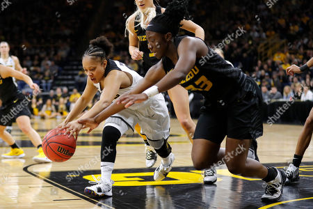 Tania Davis, Amber Smith. Iowa guard Tania Davis, left, fights for a loose ball with Missouri guard Amber Smith during a second round women's college basketball game in the NCAA Tournament, in Iowa City, Iowa
