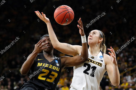 Hannah Stewart, Amber Smith. Missouri guard Amber Smith (23) fights for a rebound with Iowa forward Hannah Stewart (21) during a second round women's college basketball game in the NCAA Tournament, in Iowa City, Iowa