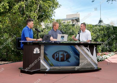 Stock Photo of Buffalo Bills General Manager Brandon Beane, right, speaks to the host of Pro Football Talk, Mike Florio, left, and Chris Simms about the team's draft needs during an interview at the annual NFL owners meetings, in Phoenix