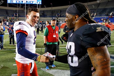 Memphis Express quarterback Johnny Manziel (2) is congratulated by Birmingham Iron running back Trent Richardson (33) after a Birmingham Iron at Memphis Express AAF football game, at Liberty Bowl Memorial Stadium in Memphis, Tenn. against the Memphis won in overtime 31-25