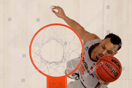 Virginia Tech guard Justin Robinson scores against Liberty during the first half of a second-round game in the NCAA men's college basketball tournament, in San Jose, Calif