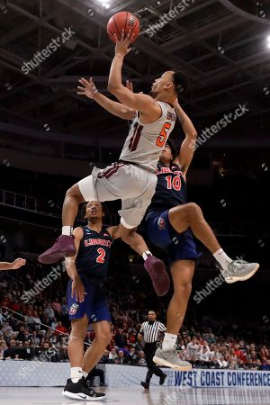 Virginia Tech guard Justin Robinson drives to the basket past Liberty guards Darius McGhee (2) and Elijah Cuffee (10) during the second half of a second-round game in the NCAA men's college basketball tournament, in San Jose, Calif