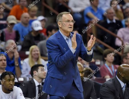 Oklahoma coach Lon Kruger applauds his team during the second half of a second-round men's college basketball game against Virginia in the NCAA Tournament in Columbia, S.C