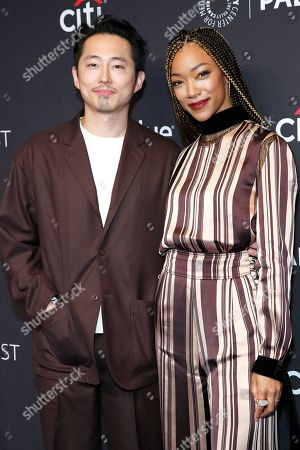 Stock Image of Korean-American actor Steven Yeun (L) and US actress Sonequa Martin-Green arrive for The Paley Center for Media's PaleyFest LA 2019 presentation for the television show 'The Twilight Zone' at the Dolby Theatre in Los Angeles, California, USA, 24 March 2019.