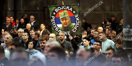 Citizens of Belgradecarry a banner with a picture of the Commander of the Army of Republika Srpska Ratko Mladic at a gathering outside the General Staff building, after which they walked through the streets of Belgrade to the Russian Embassy, marking the 20th anniversary of the North Atlantic Treaty Organization (NATO) bombing of Yugoslavia; in Belgrade, Serbia, 24 March 2019. The NATO bombing of the Federal Republic Yugoslavia began 20 years ago in which, according to unofficial sources, about 2,500 civilians and about 1,000 soldiers and police officers died in 11 weeks. In the 78-day bombardment, infrastructure, businesses, health facilities, media outlets and military facilities were badly damaged. The NATO action came after unsuccessful negotiations on a solution to the Kosovo crisis in Rambouillet and Paris, February and March 1999. The bombing of Yugoslavia ended on 10 June, with the adoption of UN Security Council Resolution 1244, followed by the withdrawal of the army and police from the province and the entry of international military troops.