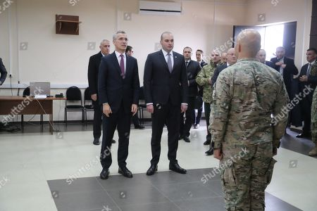 Georgian Prime Minister Mamuka Bakhtadze (R) stands with NATO Secretary General Jens Stoltenberg (L) during the 'NATO-Georgia Exercise 2019' at the NATO-Georgia Joint Training and Evaluation Centre in Krtsanisi outside Tbilisi, Georgia, 25 March 2019. Jens Stoltenberg is on an official visit to Georgia. His program includes observing the NATO-Georgia exercise in Georgia.