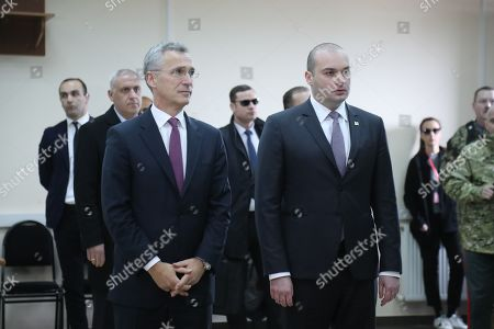Georgian Prime Minister Mamuka Bakhtadze (R) stand with NATO Secretary General Jens Stoltenberg (L) during the  'NATO-Georgia Exercise 2019' at the NATO-Georgia Joint Training and Evaluation Centre in Krtsanisi outside Tbilisi, Georgia, 25 March 2019. Jens Stoltenberg is on an official visit to Georgia. His program includes observing the NATO-Georgia exercise in Georgia.