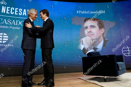 Stock Picture of Leader of Spanish People's Party (PP) Pablo Casado (R) greets Adolfo Suarez Illana (L), son of Spain's first Prime Minister in Democracy Adolfo Suarez during the forum 'The Needed Spain' organized by El Mundo diary newspaper in Madrid, Spain, 25 March 2019. Spanish PP presents Adolfo Suarez Illana as their number two for the 28 April general elections, in which Pablo Casado runs for the Prime Minister's office.