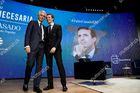 Stock Photo of Leader of Spanish People's Party (PP) Pablo Casado (R) greets Adolfo Suarez Illana (L), son of Spain's first Prime Minister in Democracy Adolfo Suarez during the forum 'The Needed Spain' organized by El Mundo diary newspaper in Madrid, Spain, 25 March 2019. Spanish PP presents Adolfo Suarez Illana as their number two for the 28 April general elections, in which Pablo Casado runs for the Prime Minister's office.