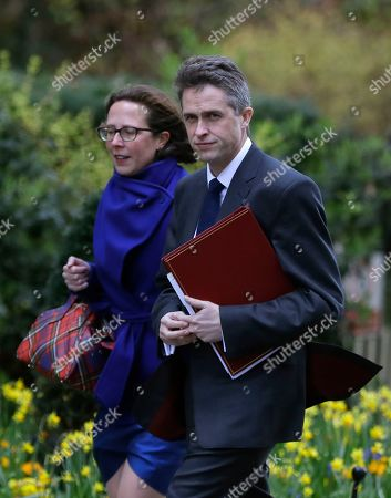Gavin Williamson, Secretary of State for Defence, right, and Baroness Evans of Bowes Park, Leader of the House of Lords arrive for a Cabinet meeting at Downing Street in London, . Embattled Prime Minister Theresa May was scrambling Sunday to win over adversaries to her Brexit withdrawal plan as key Cabinet ministers denied media reports that they were plotting to oust her