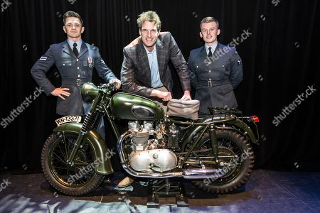 Dan Snow with Corporal Matthew Brain, RAF Northolt, (wearing medal) and SAC Karl Cassar, RAF Northolt with the iconic Triumph TR6 motorcycle made famous in the film