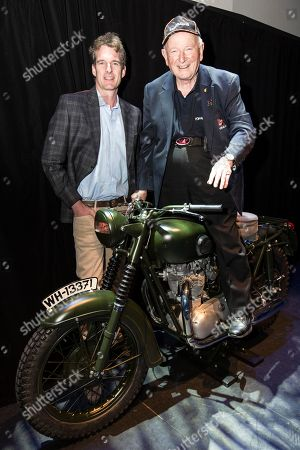 Stock Photo of Dan Snow with Tim Gibbes stunt man in the iconic Hollywood movie 'The Great Escape', now aged 85, sitting on the original Triumph TR6 motorcycle made famous in the film