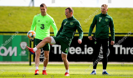 Glenn Whelan with Kevin Long and Aiden O'Brien