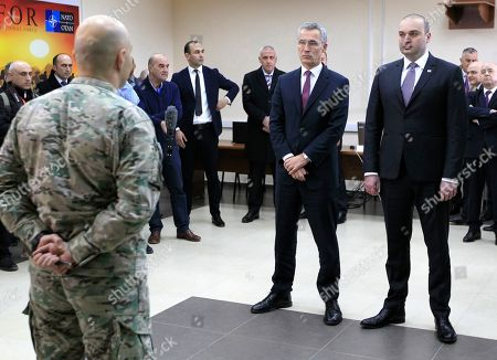 NATO Secretary General Jens Stoltenberg and Georgian Prime Minister Mamuka Bakhtadze, right, meet with Georgian soldiers during multinational military exercises NATO - Georgia Exercise 2019 at the NATO-Georgia Joint Training and Evaluation Center in Krtsanisi, just outside Tbilisi, Georgia