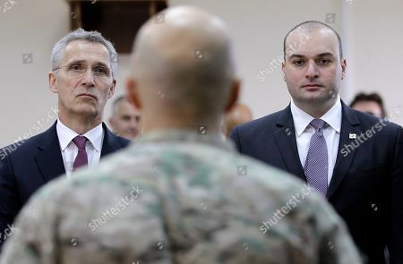NATO Secretary General Jens Stoltenberg and Georgian Prime Minister Mamuka Bakhtadze, right, meet with Georgian soldiers during multinational military exercises NATO - Georgia Exercise 2019, at the NATO-Georgia Joint Training and Evaluation Center in Krtsanisi, just outside Tbilisi, Georgia