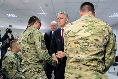 NATO Secretary General Jens Stoltenberg, centre, and Georgian Prime Minister Mamuka Bakhtadze, background left, meet with veterans of Georgian army during multinational military exercises NATO - Georgia Exercise 2019 at the NATO-Georgia Joint Training and Evaluation Center in Krtsanisi, just outside Tbilisi, Georgia