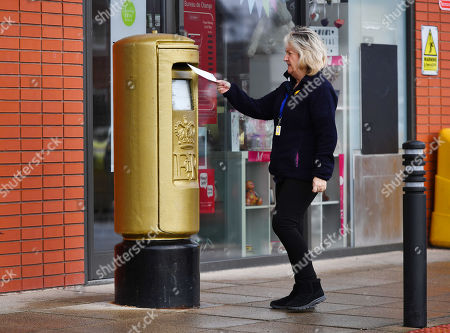 Stock Image of Gold Royal Mail Postbox In Disgraced Cyclist Bradley Wiggins Home Town Of Eccleston Lancs. Which Was Painted Gold In Honour Of His Olympic Gold Medal Win.