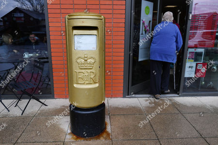 Editorial image of Gold Royal Mail Postbox In Disgraced Cyclist Bradley Wiggins Home Town Of Eccleston Lancs. Which Was Painted Gold In Honour Of His Olympic Gold Medal Win.
