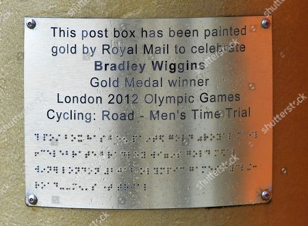 Gold Royal Mail Postbox In Disgraced Cyclist Bradley Wiggins Home Town Of Eccleston Lancs. Which Was Painted Gold In Honour Of His Olympic Gold Medal Win.