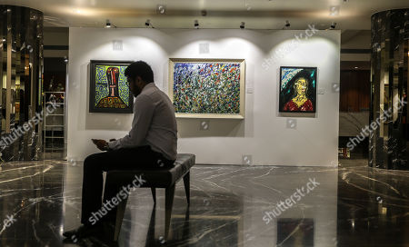 A general view of the paintings kept for auctions in the art gallery in Mumbai, India, 25 March 2019. Many paintings worth thousands of dollars allegedly seized by the Indian Income tax department and Indian revenue department from businessman Nirav Modi, a prime accused Punjab National Bank scam as part of the probe to recover dues  worth millions of dollars. The auction is scheduled for 27 March.