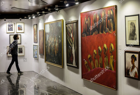Stock Picture of A general view of the paintings kept for auctions in the art gallery in Mumbai, India, 25 March 2019. Many paintings worth thousands of dollars allegedly seized by the Indian Income tax department and Indian revenue department from businessman Nirav Modi, a prime accused Punjab National Bank scam as part of the probe to recover dues  worth millions of dollars. The auction is scheduled for 27 March.