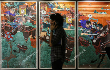 Stock Photo of A general view of the paintings kept for auctions in the art gallery in Mumbai, India, 25 March 2019. Many paintings worth thousands of dollars allegedly seized by the Indian Income tax department and Indian revenue department from businessman Nirav Modi, a prime accused Punjab National Bank scam as part of the probe to recover dues  worth millions of dollars. The auction is scheduled for 27 March.