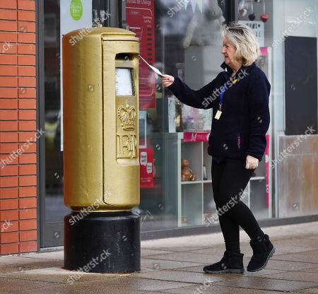 Editorial photo of Gold Royal Mail Postbox In Disgraced Cyclist Bradley Wiggins Home Town Of Eccleston Lancs. Which Was Painted Gold In Honour Of His Olympic Gold Medal Win.