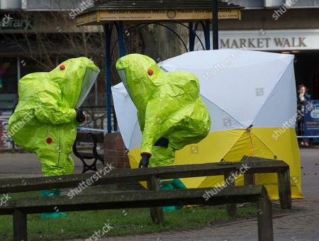 Officers Wearing Chemical Protection Suits Secure Forensic