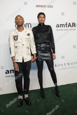 US singer Pharrell Williams (L) and wife Helen Lasichanh (R) arrive for the amfAR fundraising Gala Hong Kong 2019 in Hong Kong, China, 25 March 2019. The charity event benefits the foundation's AIDS research programs.