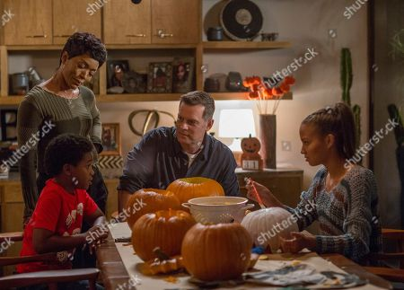 Stock Photo of Marcanthonee Reis as Harry Grant, Angela Bassett as Athena Grant, Peter Krause as Bobby Nash and Corinne Massiah as May Grant