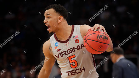 Virginia Tech guard Justin Robinson plays against Liberty during a second-round game in the NCAA men's college basketball tournament, in San Jose, Calif