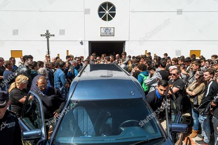Relatives and friends attend the funeral of Spanish 14-year-old rider Marcos Garrido in Cadiz, southern Spain, 25 March 2019. Garrido died on 24 March 2019 during a race at Jerez-Angel Nieto circuit in Spain when he was run over by another participant just after he crashed.