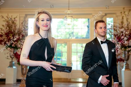 Theranos Inc. Founder and CEO Elizabeth Holmes, left, and Christian Holmes arrive for a state dinner for Japanese Prime Minister Shinzo Abe, at the White House in Washington