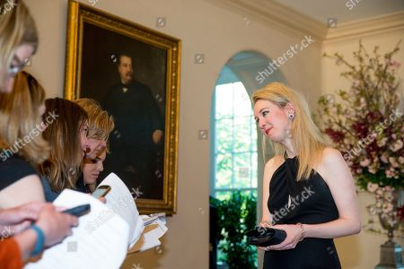 Theranos Inc. Founder and CEO Elizabeth Holmes, right, speaks to members of the media as she arrives for a state dinner for Japanese Prime Minister Shinzo Abe, at the White House in Washington