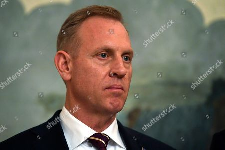 Acting Defense Secretary Patrick Shanahan listens during a proclamation signing with President Donald Trump and Israeli Prime Minister Benjamin Netanyahu in the Diplomatic Reception Room at the White House in Washington