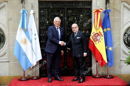 Agrentina's Foreign Minister Jorge Marcelo Faurie (R) greets his Spanish counterpart Josep Borrell (L) prior a meeting in Buenos Aires, Argentina, 25 March 2019.