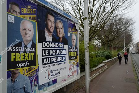 Posters showing French former presidential election candidate for the Popular Republican Union (UPR) party Francois Asselineau (L), known for his Frexit campaign and French Member of Parliament and President of the Rassemblement National (RN) far-right party Marine Le Pen (L) and Jordan Bardella (C) are displayed in Calais, northern France, 22 March 2019, issued 25 March 2019. Reports state that Theresa May updated ministers on her Brexit strategy at a meeting of her cabinet earlier on 25 March 2019 which comes as the EU announced that its preparation for a no-deal scenario has been completed. Members of Parliament are expected to vote on a series of alternatives to the Prime Minister's Brexit deal.