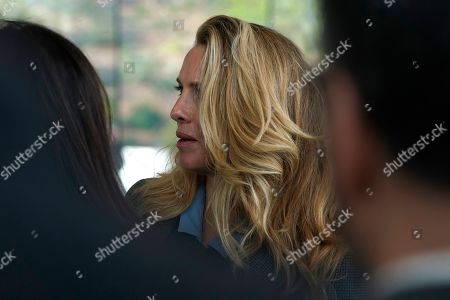 Stock Picture of Laurene Powell, the widow of Steve Jobs, waits to enter the Steve Jobs Theater for an event to announce new products, in Cupertino, Calif