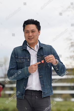 Stock Image of Director Jon M. Chu, poses for a photo outside the Steve Jobs Theater during an event to announce new Apple products, in Cupertino, Calif