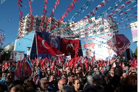 People listen to Meral Aksener, the leader of opposition IYI (Good) Party, as she addresses the supporters during a rally in Ankara, Turkey, . The countrywide local elections are scheduled for March 31, 2019 with 57 millions registered voters