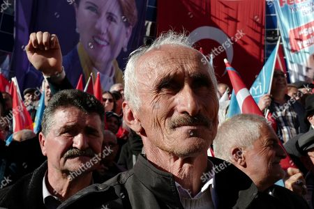 People listen to Meral Aksener, the leader of opposition IYI (Good) Party, as she addresses her supporters during a rally in Ankara, Turkey, . The countrywide local elections are scheduled for March 31, 2019 with 57 millions registered voters
