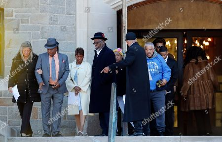 """Family members of the late Aretha Franklin gather before entering the Mausoleum Chapel at the Woodlawn Cemetery, in Detroit. Family celebrated Franklin and other passed family members with a memorial service inside a chapel at the cemetery on what would have been the Queen of Soul's 77th birthday. Franklin died last year after battling pancreatic cancer. Sabrina Owens, Franklin's niece, says """"our family thought it might be a good idea for us to start the day the right way _ in prayer"""