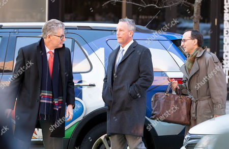 Martin Fox of Houston Texas (C) enters the John Joseph Moakley Federal Court House in Boston, Massachusetts, USA, 25 March 2019. Fox was set to plead not guilty to charges stemming from his alleged involvement with private athletics groups in what federal prosecutors in the U.S. Attorney's Office in Massachusetts call Operation Varsity Blues.