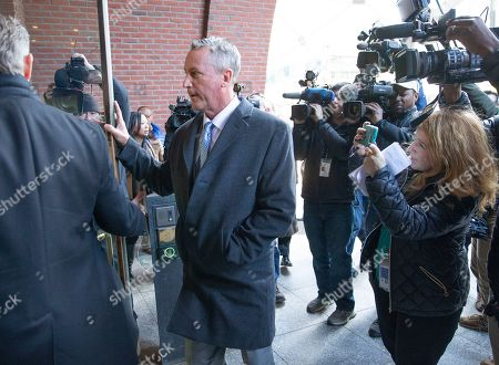 Martin Fox of Houston Texas (C) enters the John Joseph Moakley Federal Court House in Boston, Massachusetts, USA 25 March 2019. Fox was set to plead not guilty to charges stemming from his alleged involvement with private athletics groups in what federal prosecutors in the U.S. Attorney's Office in Massachusetts call Operation Varsity Blues.
