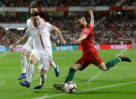 Portugal's Rafa Silva kicks the ball ahead of Serbia's Antonio Rukavina during the Euro 2020 group B qualifying soccer match between Portugal and Serbia at the Luz stadium in Lisbon, Portugal
