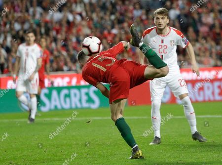 Portugal's Rafa Silva kicks the ball ahead of Serbia's Adem Ljajic during the Euro 2020 group B qualifying soccer match between Portugal and Serbia at the Luz stadium in Lisbon, Portugal